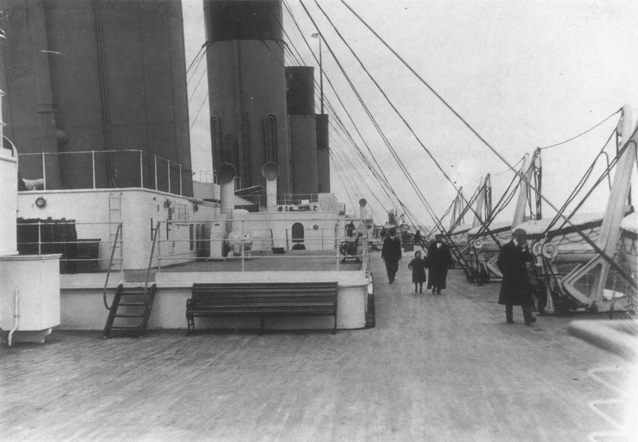 Passengers walking on the Boat Deck.