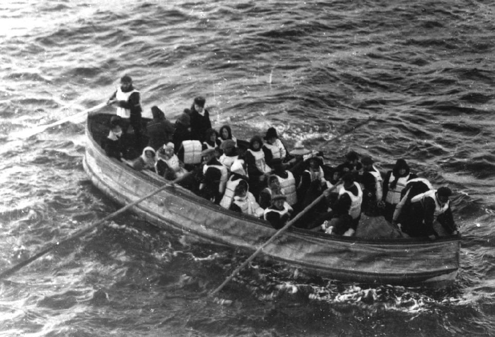Titanic survivors in a lifeboat. The photo was taken from a passenger onboard the Carpathia.