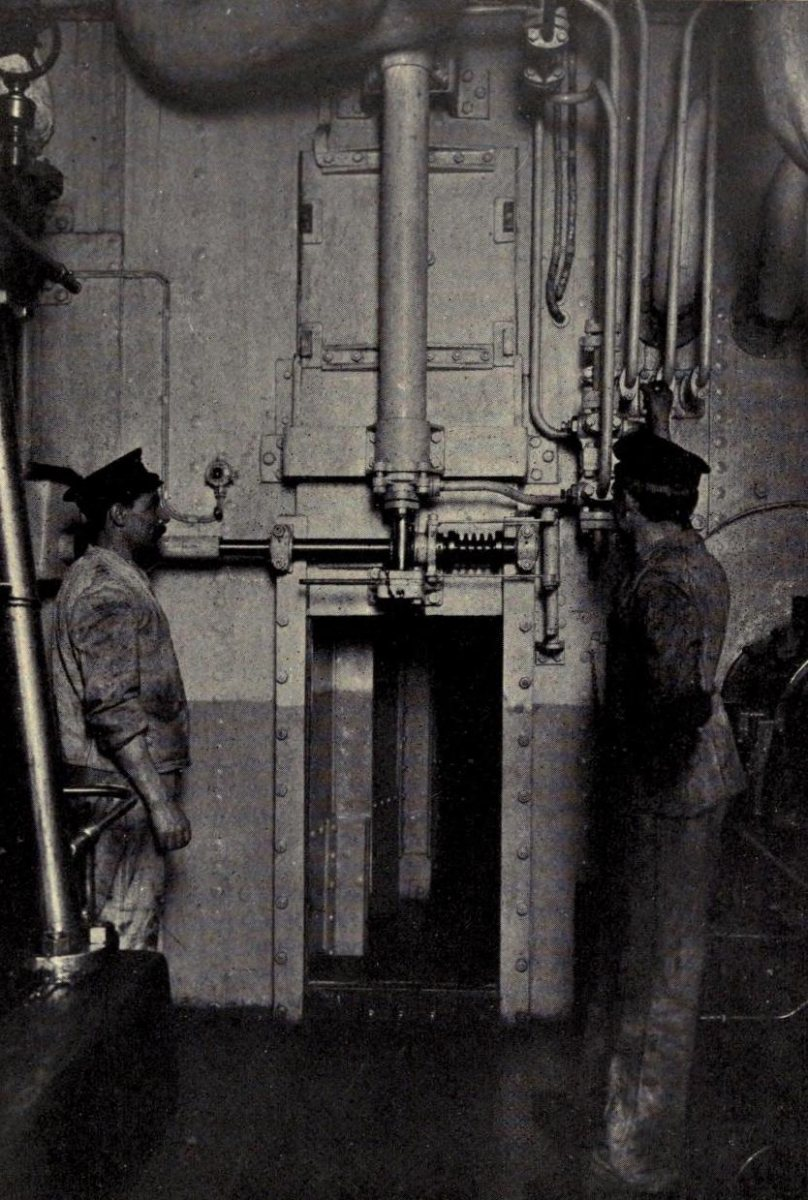 A hydraulically operated watertight door at the engine room bulkhead.