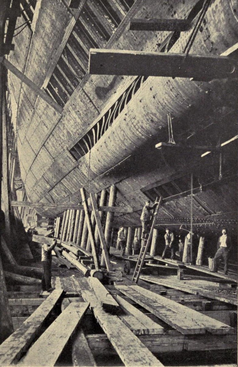 Rivetting the outer skin of the frames during the construction of the Titanic.