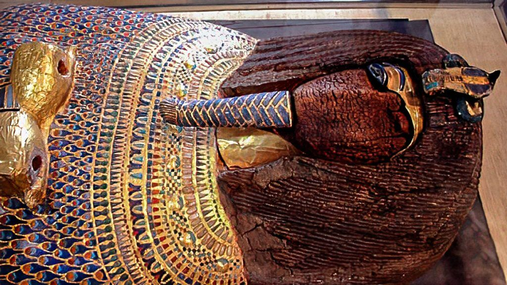 Gilded and inlaid wooden coffin from KV55 in the Valley of the Kings, now in the Egyptian Museum of Antiquities in Cairo. The face and the cartouche containing the name of the coffin's occupant were defaced in ancient times. Image: Hans Ollermann