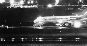 A hijacked Northwest Airlines jetliner 727 sits on a runway for