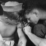 Tattooed sailor aboard the USS New Jersey in 1944