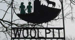 The Sign for Woolpit Village Showing the Green Children courtesy of Red Bacon