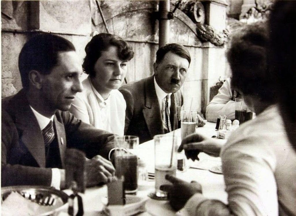 Geli Raubal (L) and Adolf Hitler (R) at a garden party in the 1930s. Photo by: Universal History Archive/Universal Images Group.