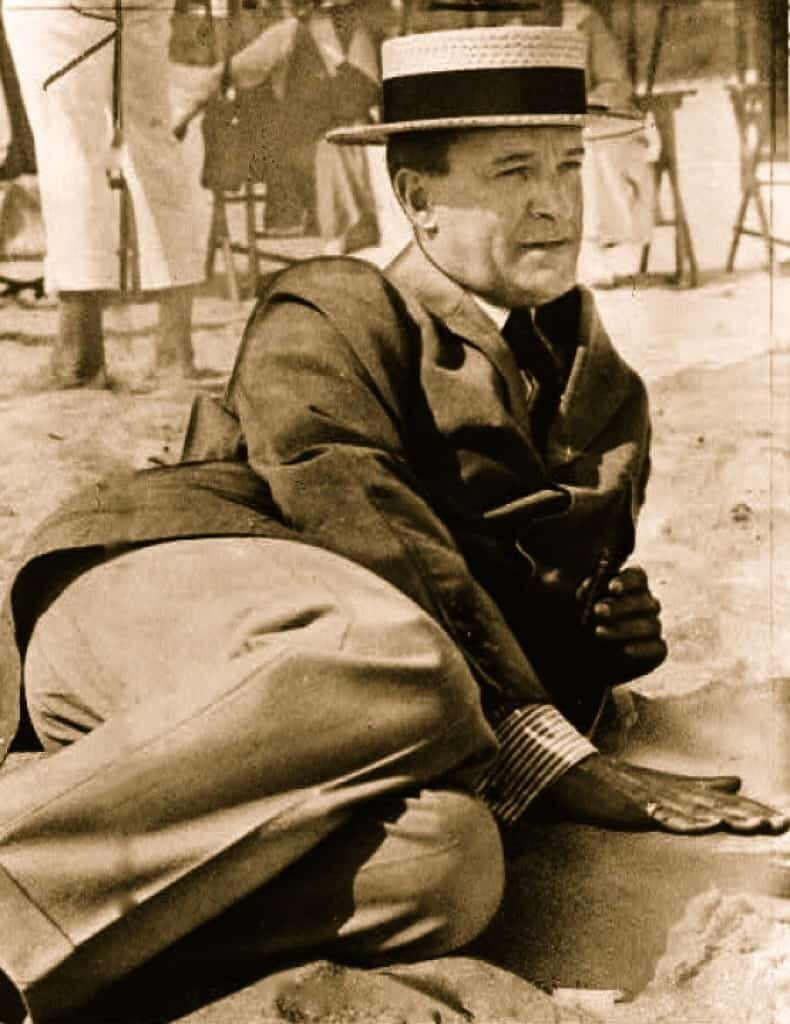 Joseph Bowne Elwell reclining on the Florida sands shortly before his death in 1920.