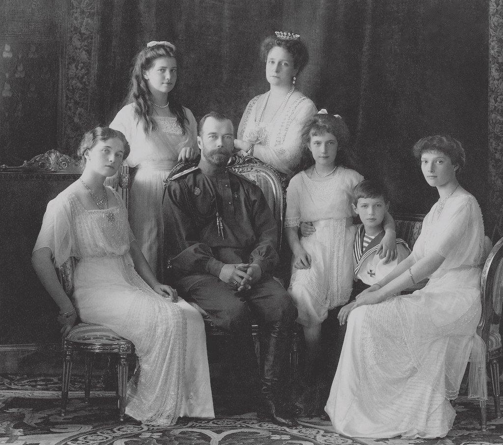 The Romanov family (left to right): Olga, Maria, Nicholas II, Alexandra Fyodorovna, Anastasia, Alexei, and Tatiana.