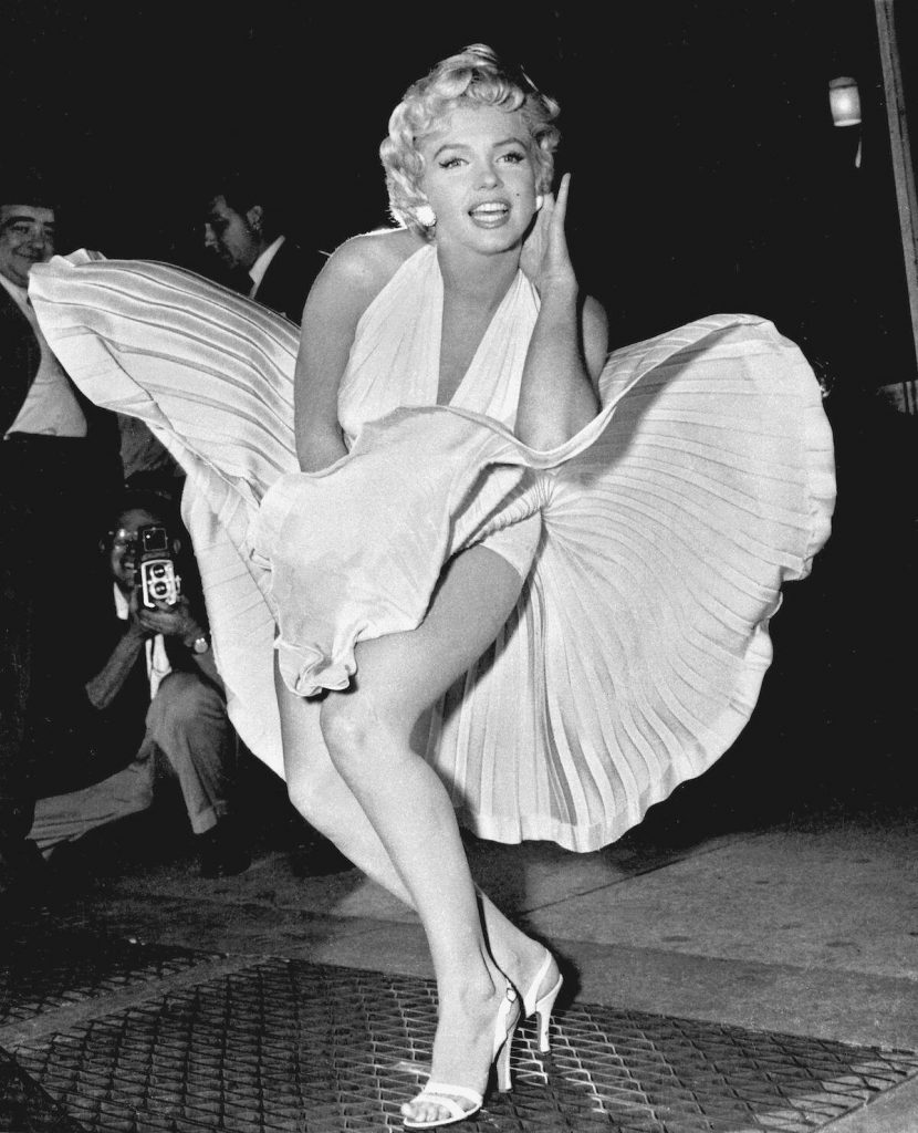 Photo of Marilyn Monroe while filming The Seven Year Itch on the streets of New York.