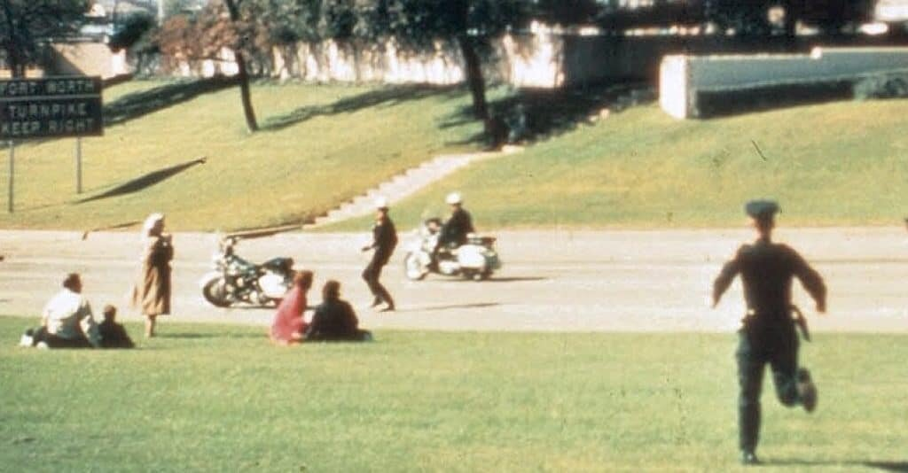 Babushka lady, left, in tan coat and light scarf appears unshaken seconds after the fatal shot.