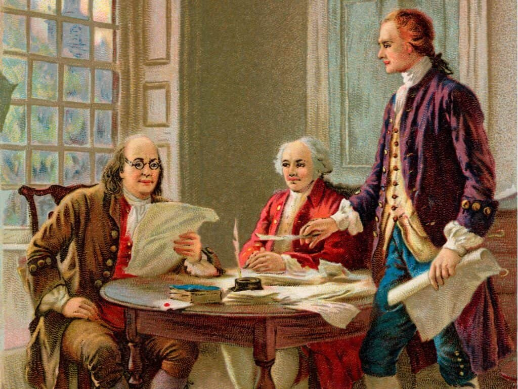 Benjamin Franklin, John Adams and Thomas Jefferson reviewing a draft of t he Declaration of Independence.