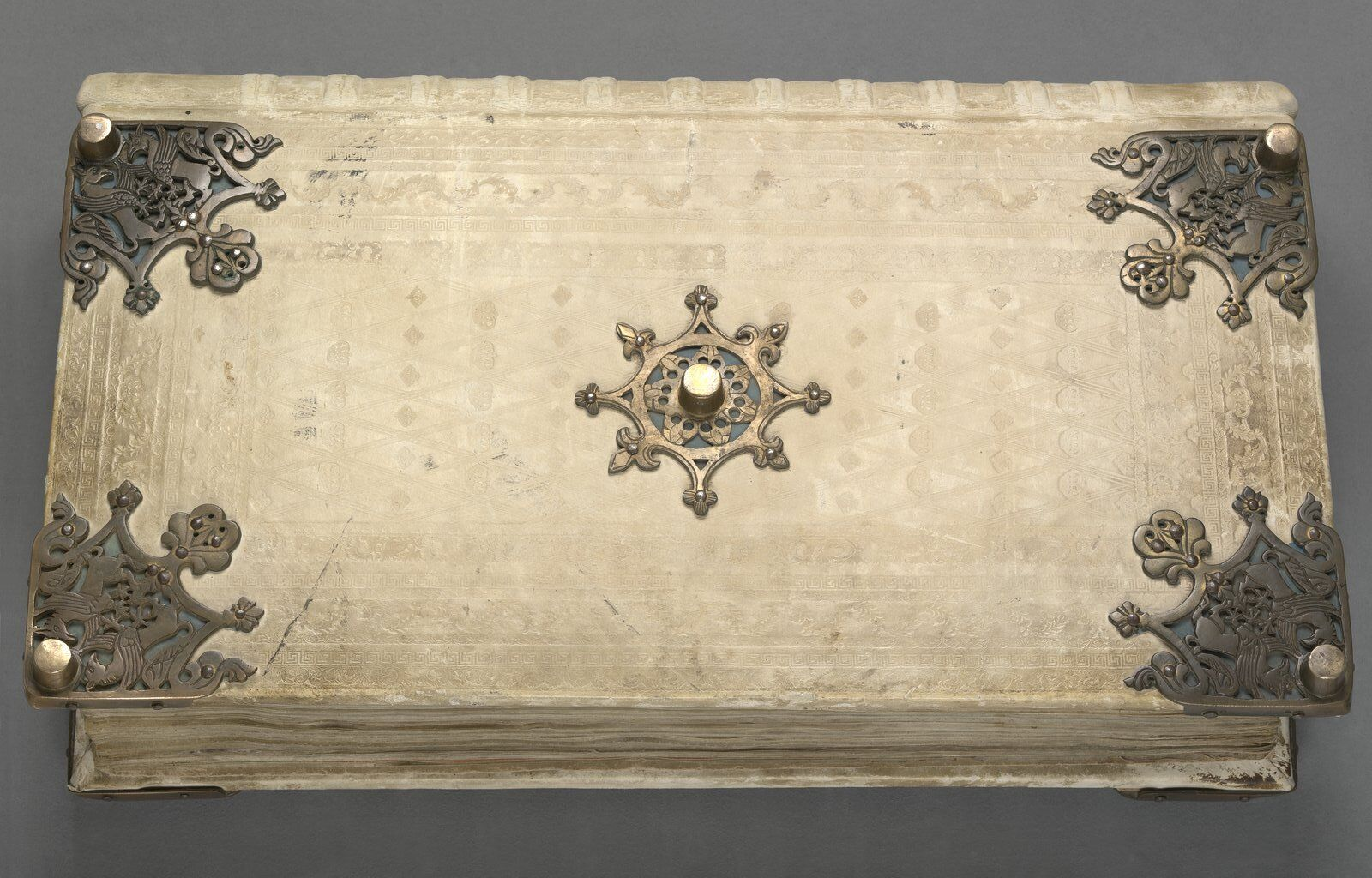 Five metal plates decorate the Devil's Bible.