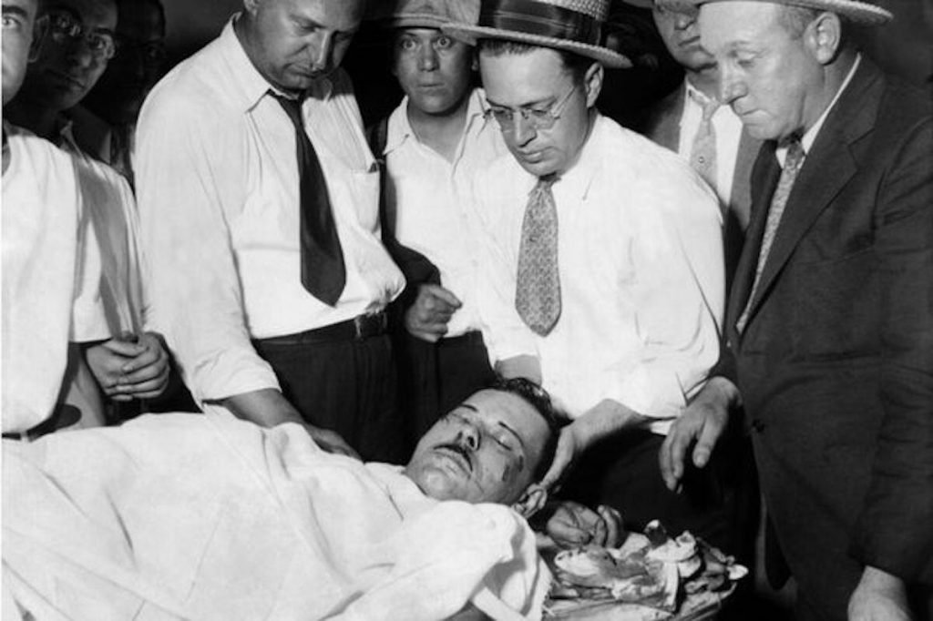 The body of John Dillinger surrounded by policemen and the coroner's assistant. Many people claim the body was not that of John Dillinger. Did he escape death and lived the rest of his life under an assumed identity?