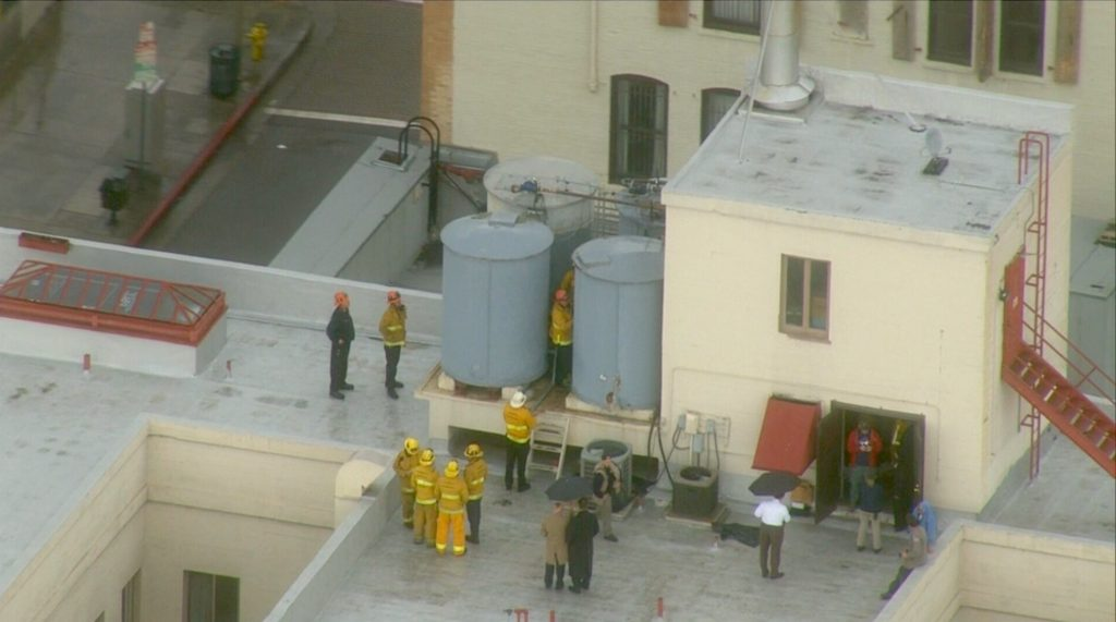 Footage of the recovery effort to remove Lam's body from water tanks of the Cecil Hotel.
