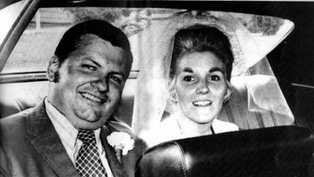 John on his wedding day with Carole Hoff.