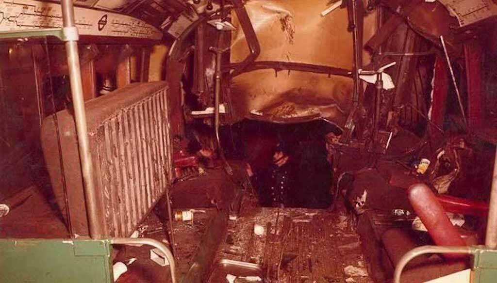 A man examines the destruction of the Moorgate train crash. Photo: London Fire Brigade.