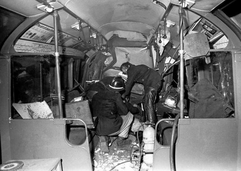Emergency personnel comb through the moorgate train crash..