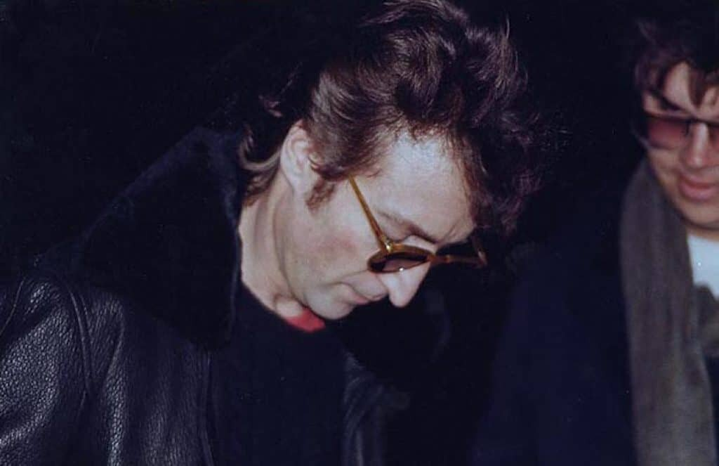 John Lennon (L) shortly before being killed by Mark Chapman (R).