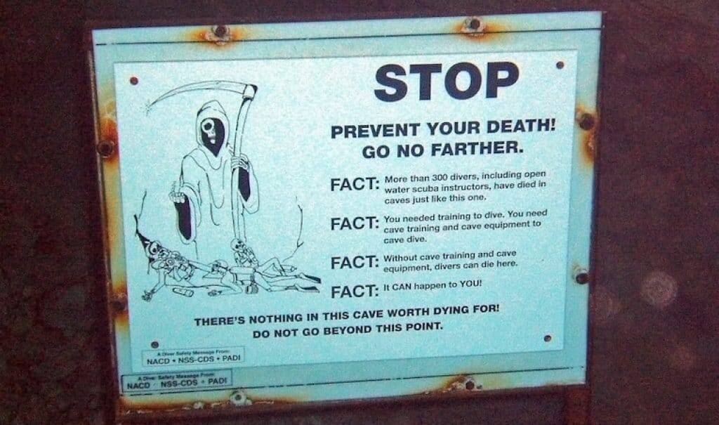 A warning sign at the entrance to the cave. Image: Greg Grimes from Starkville, MS, USA