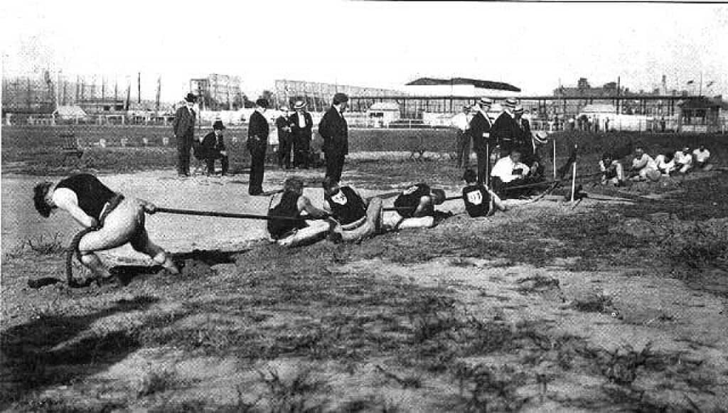 The Tug of War competition from 1904 is a discontinued Olympic sport. Public domain.