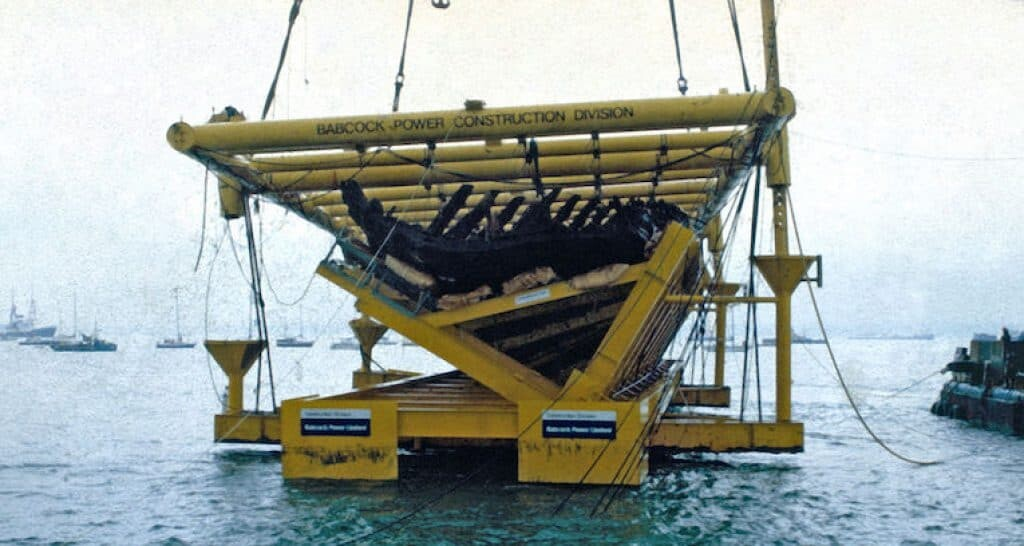 Recovery of the Mary Rose wreck as it clears the water in 1982.