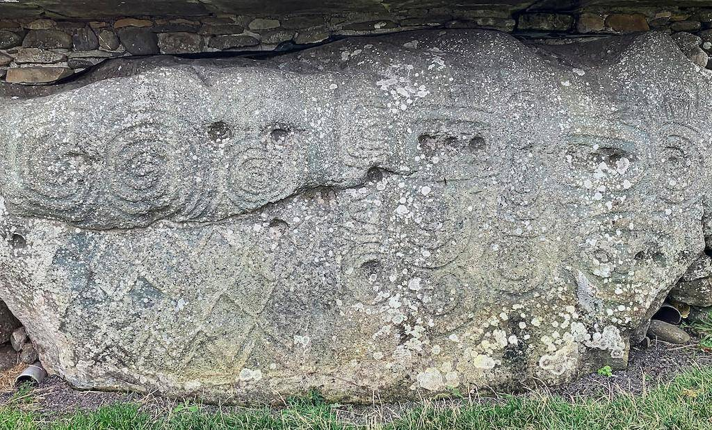 One of the kerbstones of the Newgrange mound displaying ancient designs.