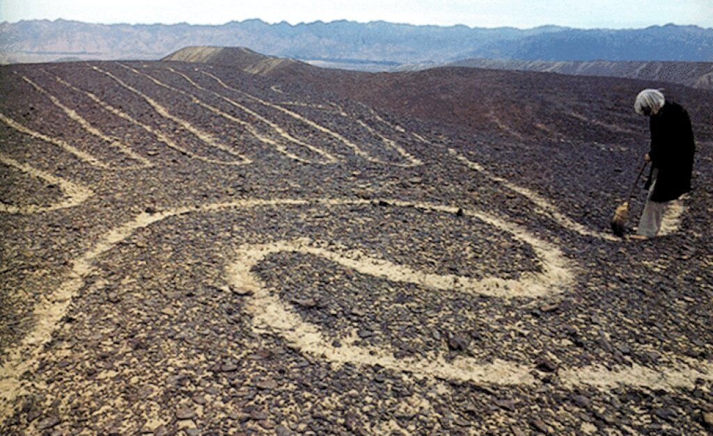 Nazca lines are made by clearing away red stones to reveal white underneath. Source: unknown