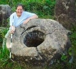 Lia Genovese with stone jar in the Plain of Jars