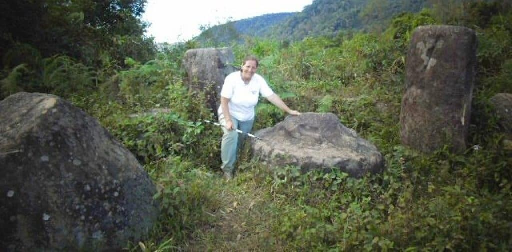 Genovese standing by disc in the plain of jars