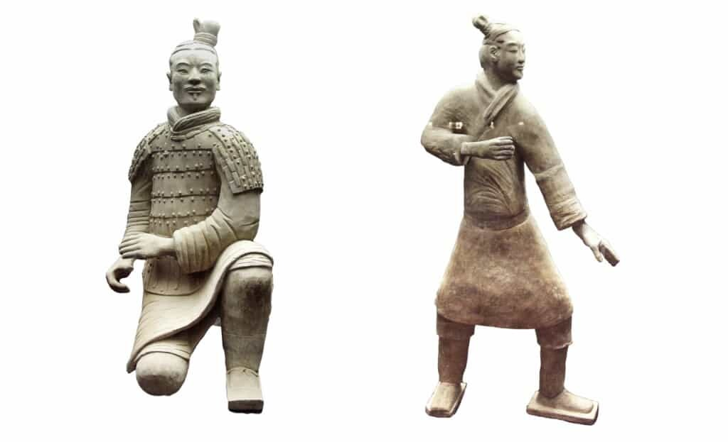 Warriors from Pit 2. (L)Kneeling archer. (R) Standing archer who would have held a longbow.
