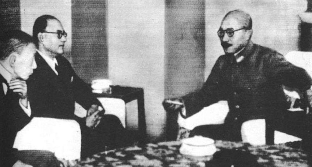 Bose (back left) meeting with Japanese army General Hideki Tojo (R) in Tokyo. 1943. Public domain.