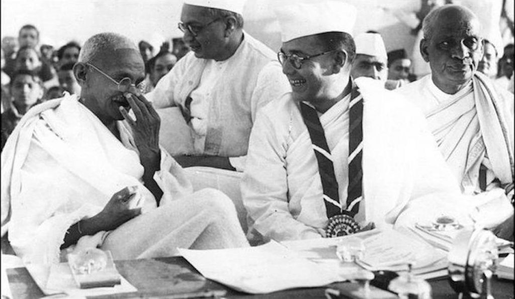 Members of the Indian National Congress (foreground left to right) Mahatma Gandhi, Bose, and Vallabhai Patel during the 51st Indian National Congress, 1938. Public domain.