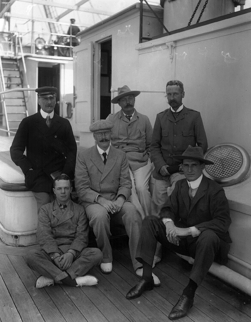 Doyle (center) and Robinson with glasses sitting to his right, 1900.