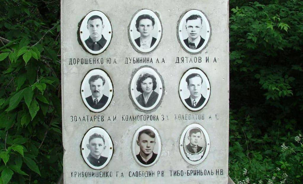 The faces of the Dyatlov Pass victims on a memorial stone. Public domain.