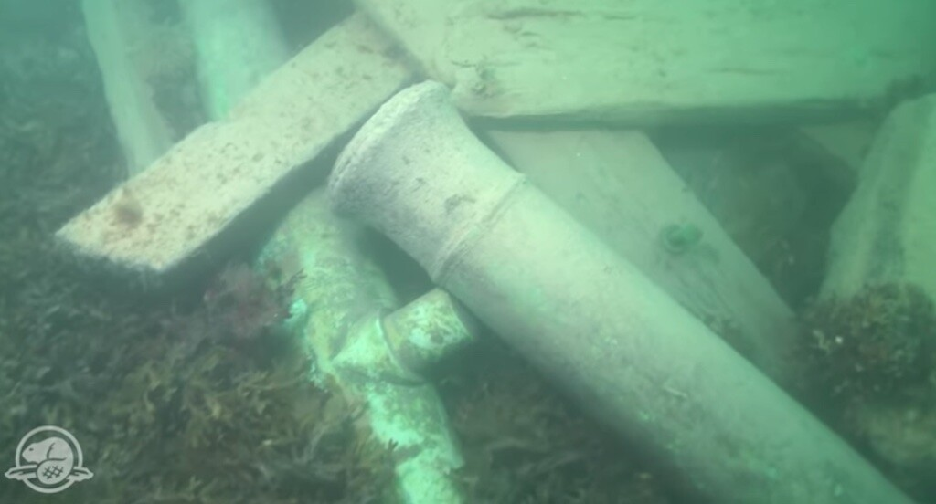 Two cannons still lay on the stern of HMS Erebus. Screenshot of footage at <a href=