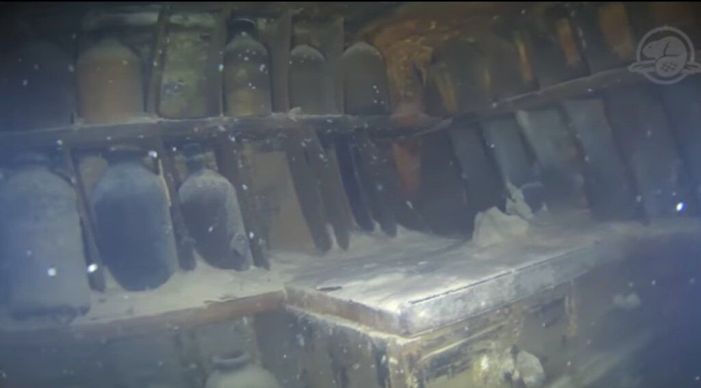 Containers and boxes remain amongst the incredible artifacts of HMS Terror. Screenshot of footage at <a href=