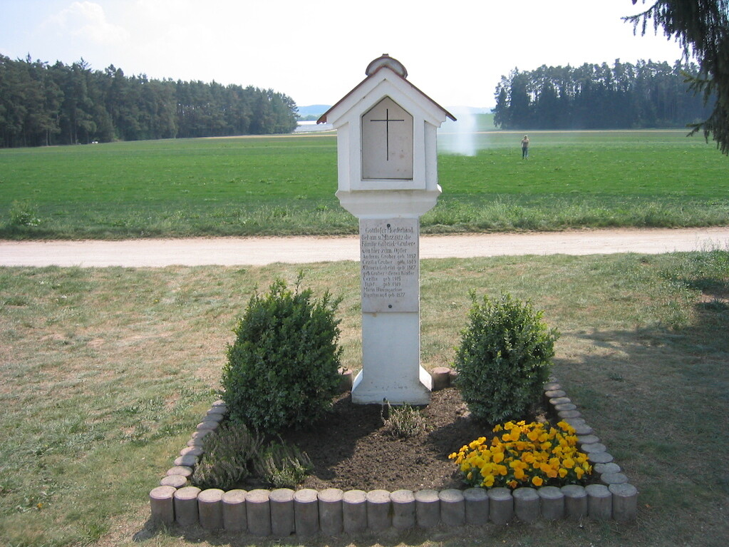 "The Hinterkaifeck Murders Shrine near the vicinity of the crime scene. The shrine reads ""On March 31, 1922, the Gabriel-Gruber family fell victim to the ungodly hand of the murderer"". It goes on to include the names and years of birth of the victims."