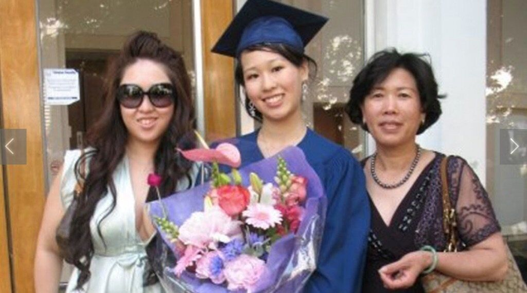 Elisa on her graduation day with her sister and mother. Image: Facebook.