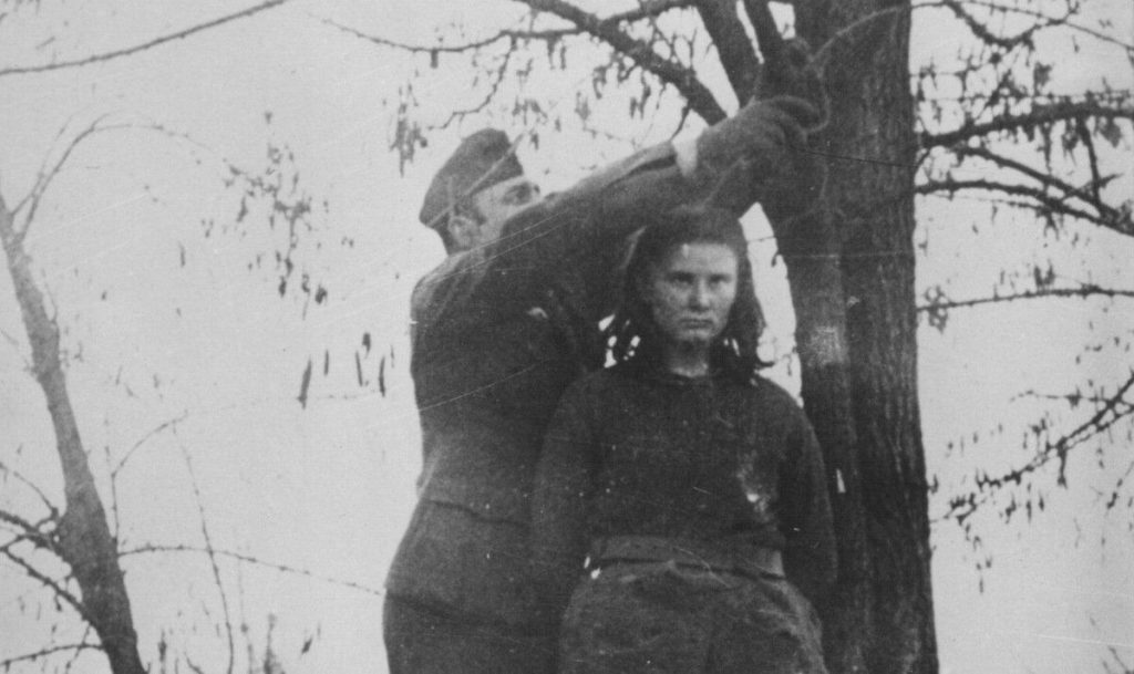 A German official prepares a noose to hang Lepa Svetozara Radić on February 8th, 1943.