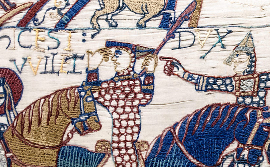 William, Duke of Normandy, removes his helmet to reassure his troops.