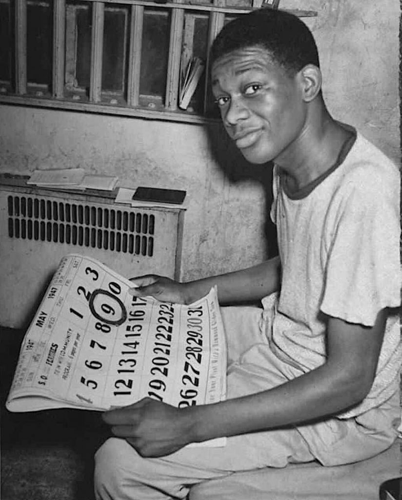Willie Francis holds a calendar showing the date of his execution circled.
