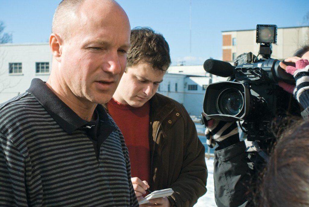 Darrel Rice being interviewed by a journalist.